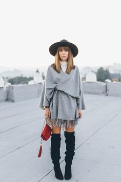 Get creative with layering as Jenny of Margo & Me did by belting a scarf over a turtleneck dress. We like how the fringe on her scarf reveals just a hint of skin, because acing this look is all about showing the right amount of leg between your hemline and the top of your boots.