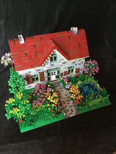 Karen Metz has nearly completed a limestone Minifigure house. The home has so much detail; my favorite part is the subtle curved sidewalk!