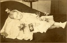 Little girl with a picture of her as a baby