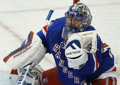 New York Rangers goalie Henrik Lundqvist (30) grabs a shot on goal by the Pittsburgh Penguins during the second period of Game 5 in the first round of the NHL hockey Stanley Cup playoffs, Friday, April 24, 2015, in New York. (AP Photo/Julie Jacobson)