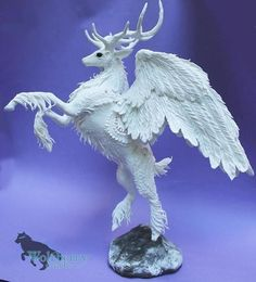 Hey, I found this really awesome Etsy listing at https://www.etsy.com/au/listing/535817790/white-winged-celestial-deer-figure