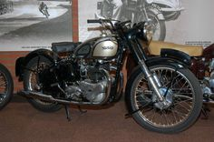 1949 Norton Dominator Model 7 500cc. Although Rem Fowler won the 1907 TT on a Peugeot engined V-twin Norton, the firm had a long tradition of manufacturing single cylinder machines only. The first notice of separture from this practice was the announcement in November 1948 of a high performance 497cc ohv vertical twin.  The complete machine was based on the ES2 frame, forks and hearbox but the engine, designed by Bert Hopwood, was completely new and was to be the basis of the range of Norton…
