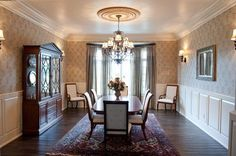Meticulous and intricate faux wallpaper design in this elegant dining room