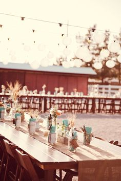 Colored napkins in the jars... have candles underneath ready to be lit once everyone is seated?
