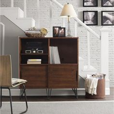 Versatile and multi-functional, this Retro Clarence Media Bookshelf Console is the perfect piece for your living room, family room, bedroom, or entry way. Finished in medium walnut brown, this console
