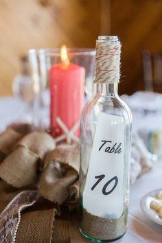 Twine-wrapped bottle for a wedding table number