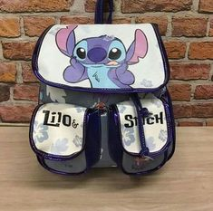 The sad thing is that this is probably too small for the crap ton of work teachers give! The sad thing is that this is probably too small for the crap ton of work teachers give! Disney Inspired Outfits, Disney Outfits, Lelo And Stich, Stitch Backpack, Stitch And Angel, Cute Stitch, Cute Backpacks, Disney Merchandise, Cute Bags