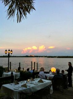 Sunset view at Ophelia's on the Bay waterfront fine dining restaurant on Siesta Key in Sarasota, Florida.