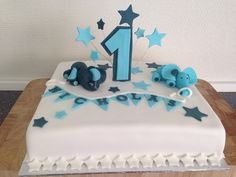 1. Birthday cake for a little boy with 2 sweet elephants and Stars.