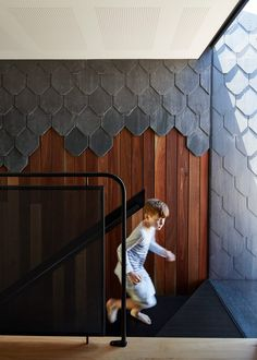 Diamond, scalloped and brick-shaped shingles cover Melbourne house by Austin Maynard Architects