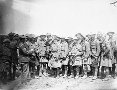 Rum issue to men of the 8th Battalion, Black Watch in the Carnoy Valley soon after the return of the 26th Infantry Brigade, 9th (Scottish) Division, from heavy fighting in the village of Longeuval, 14 - 19 July 1916