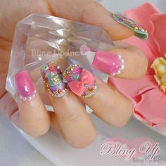 handmade 3d nail art ribbon and a gold birdcage relief, this 3d Japanese nail art set features cute roses on the mint green nail tips with a more subtle rose decoration on the pink nail tips. Gold beads and pearls provide the accent