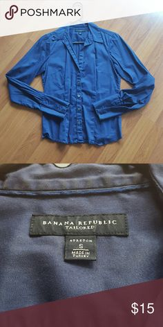 Banana Republic Navy Blue Dress Shirt BR navy blue ladies dress shirt. There are some wear around the collar as pictured in the 2nd photo. The 2nd photo also is more true to the actual color. Banana Republic Tops Button Down Shirts