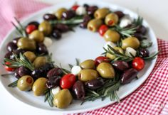 This Olive Wreath is a delicious and beautiful holiday appetizer idea. You can assemble it in minutes, and it adds a tasty and colorful touch to any party spread. Holiday Appetizers Easy Christmas, Simple Christmas, Holiday Appitizers, Christmas Parties, Thanksgiving Recipes, Holiday Recipes, Thanksgiving Holiday, Christmas Holiday, Tapas