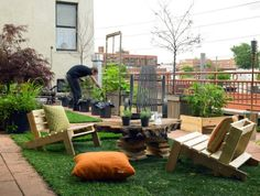 Beautiful Green Rooftop - a garden retreat in the midst of the city, created with repurposed items such as pallet chairs, tables, planters