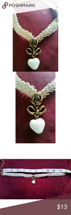 Victorian-style choker Lovely, Victorian-style choker. Attatched is a delicate bronze colored rose with a white heart dangling from it. At least 17 years old. Good used condition. Only flaw is a few frays which can be seen in photos. Would make a beautiful accent for a Steampunk cosplay. Jewelry Necklaces