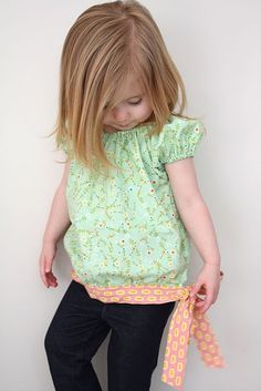 Child's blouse with hip tie.  Lots of cute tutorials on this site. #sewing