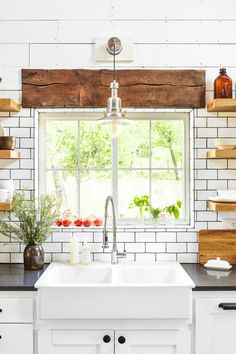 Don't Skimp on the Sink An extra-deep farmhouse sink and convenient shelving make clean up a breeze.
