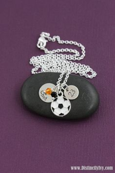 Fun soccer ball charm necklace personalized with name, number and team colors.