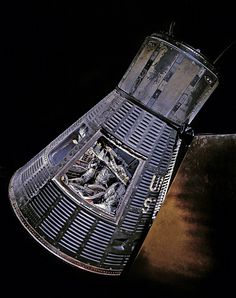 """February 20, 1962: Today in 1962: John H. Glenn Jr. became the first American to orbit the Earth in this Mercury capsule he named """"Friendship 7."""" Glenn's flight was the third piloted mission of Project Mercury, following two suborbital flights by astronauts in 1961. Glenn orbited the Earth three times and splashed down in the Atlantic 4 hours, 55 minutes, and 23 seconds after launch. """"Friendship 7"""" is currently in the Mary Baker Engen Restoration Hangar at our Udvar-Hazy Center in VA."""
