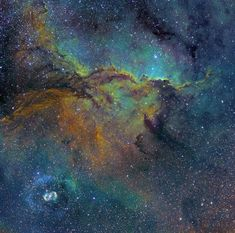 Known as the fighting dragons of Ara, two colorful gas clouds appear to be posing in attack position. Image by Australian astroimager Michael Sidonio.