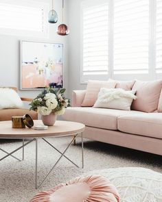Blush Pink Sofa with Abstract Art