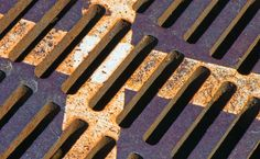 Paint stripes on an old metal street grate...    Prints available: http://jxnpx.com