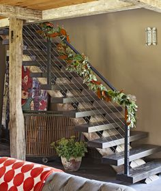 This floating staircase consists of zebrawood treads and steel bolts mounted on a monstrous beam, designed by the homeowner who loves a piece of history with a story. Staircase Railings, Staircase Design, Stairways, Banisters, Floating Staircase, Basement Inspiration, Steel Beams, House Stairs, Stairway To Heaven