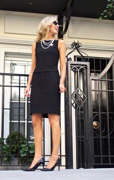 Go for a classic style in a black sheath dress. This outfit is complemented perfectly with black leather pumps.   Shop this look on Lookastic: https://lookastic.com/women/looks/black-sheath-dress-black-pumps-black-sunglasses/22603   — White Pearl Necklace  — Black Sheath Dress  — Black Leather Pumps  — Black Sunglasses