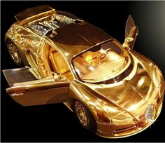 Bugatti Veyron Diamond:  the world's most expensive Car, created with platinum, solid 24ct gold, and a 7.2ct single cut flawless diamond.  WOW!!!