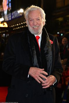 Radiant: Donald Sutherland, who plays tyrannical President Snow, swapped his white rose for a poppy