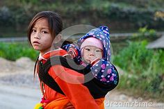 Unidentified ethnic minority kids with baskets of rapeseed flower in Hagiang, Vietnam