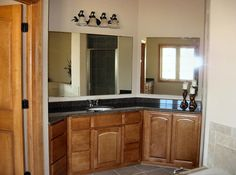 Tucked behind for total seclusion is the master suite. Amenities enhancing this private get away include a huge walk-in-closet, access to the patio, luxury bath with dual vanities, corner whirlpool, separate shower and toilet alcove.