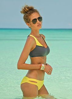 Sports bra style top with color blocking and double cross-back straps. Top has removable pads. Great sporty chic top for the active beach-goer! Low-rise hipster style bottom with cut out side details featured in vibrant daffodil color. Seamless construction and moderate to full back coverage by L Space Swimwear, $141.00