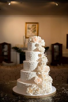 Five Tier White Wedding Cake With Cascading Flowers | Photo: Photo Love | Cake: Shelby Lynn's Cake Shop