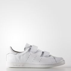 """A mutual love of fashionable minimalism led Japanese design duo Hideaki Yoshihara and Yukiko Ode to create their label, HYKE. Made in collaboration with adidas Originals, these HYKE shoes are inspired by an archival model called the """"Fast,"""" simplifying the look and adding hook-and-loop straps."""