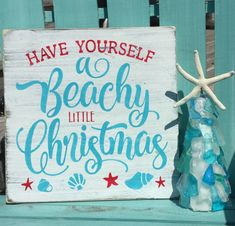 "Beach Christmas, coastal holiday beach sign, beachy Christmas, seashell sign - Our ""Have yourself a Beachy little Christmas "" sign measures and has been painted in aqu - Coastal Christmas Decor, Nautical Christmas, Christmas Signs, Little Christmas, Christmas Bedroom, Coastal Decor, Christmas Florida, Coastal Living, Purple Christmas"
