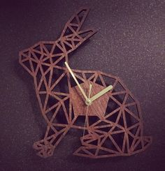 Geometric Rabbit Clock: Leeds based designer creating unique laser cut gifts from various materials. These are cut from a high quality 8mm walnut veneered mdf. Size: 30cm tall. Perfectly unique gifts.