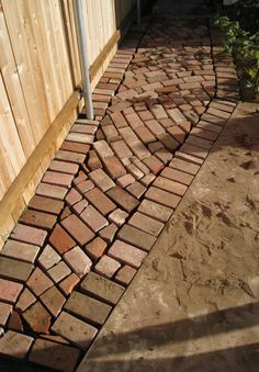 DIY–Basic steps to make attractive walkways from reclaimed brick: Start by raking to remove all weeds and debris. Level the area at the depth of the bricks. If you have expansive soil, you ma…
