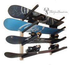 a simple and clean wooden snowboard rack for your garage that holds 4 boards
