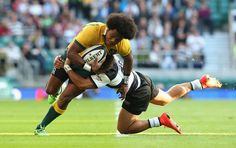 LONDON, ENGLAND - NOVEMBER 01: Henry Speight of Australia is tackled by Tim Nanai-Williams during the Killick Cup match between the Barbarians and Australian Wallabies at Twickenham Stadium on November 1, 2014 in London, England. (Photo by David Rogers/Getty Images)