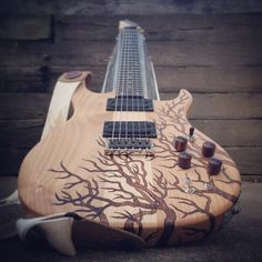 Wood-Burned, Refinished Guitar by Mike at Mad Raven Woodworks