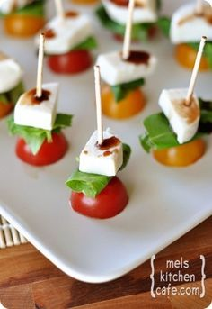 Caprese Skewers  ~1 pint cherry tomatoes  1 bunch basil leaves  8oz fresh mozzarella cheese  Balsamic vinegar, for drizzling  2-3 dozen long toothpicks/skewers  ~Slice tomatoes in half. Slice mozzarella in chunks. Slide mozzarella on toothpick. Fold basil leaf in half or thirds,nestle next to mozzarella. Slide tomato on bottom of skewer, Drizzle lightly w/vinegar.