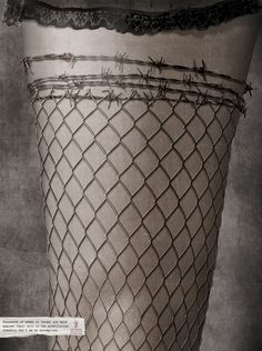 Design: An ad against illegal sex trafficking of women. Stocking resembles a fence and the top, barbed wire.
