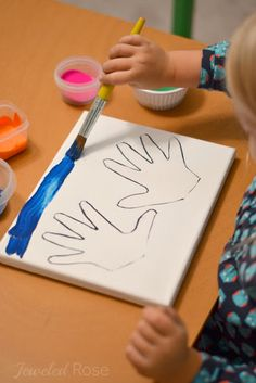 "This handprint ""paint resist"" art project is a fun art activity for kids and a great keepsake for mom and dad!"