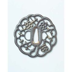 Tsuba (Sword Guard) with Monkey and Moon in Openwork Attributed to Shoami, Edo Period, Kyoto National Museum.
