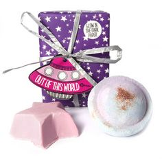 LUSH'S Out of this World - Blast off with this stellar duo of bath-time treats. Plunge Space Girl Bath Bomb into the tub and you'll be surrounded with a refreshing blackcurrant and grapefruit scent, water the color of deep space and sparkles like the stars. Our sweet vanilla Rock-Star soap gets you clean while you take your scent-sational journey. Perfect for stargazers, daydreamers and Bowie fans alike.