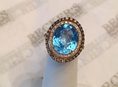 Vintage 14k rose gold Oval Blue Topaz, White and Brown Diamond Double Halo Ring, 5.89 tw, size 5.75 by BeckersJewelersCT on Etsy https://www.etsy.com/listing/265975853/vintage-14k-rose-gold-oval-blue-topaz