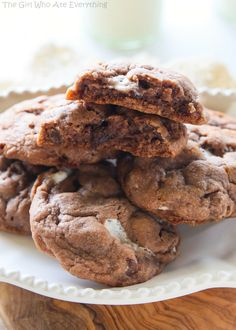 Hot Chocolate Cookies - cookies made with hot chocolate mix, milk chocolate chips, semi-sweet chocolate chips, and mini marshmallows. These cookies stay soft for days. the-girl-who-ate-everything.com