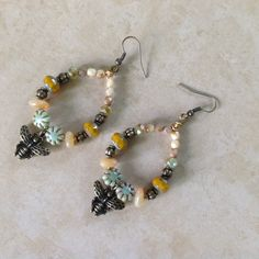 Sting Like a Bee beaded hoop earring with antique brass bee charm. Buy on CrowsFeetStudio on Etsy